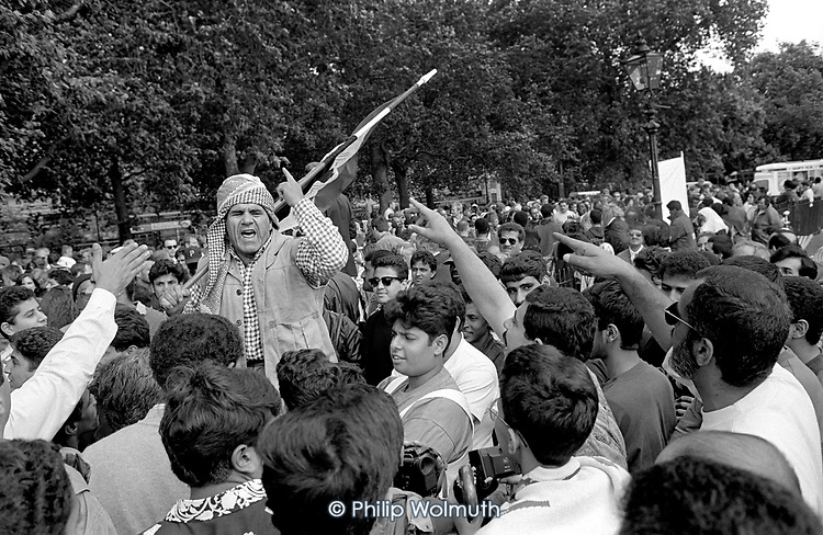 An Iraqi speakers argues, in Arabic, with an Arabic crowd at Speakers Corner, Hyde Park, London; 1993.