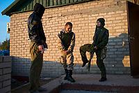 Tanya, Scharfschuetzin der pro-russischen Separatisten, Portrait, Donezk, Ukraine, 10.2014,  Tanya, 19-years old girl, the sniper of the pro-Russian militia making a jokes with her commarades befor going to the frontline.  ***HIGHRES AUF ANFRAGE*** ***VOE NUR NACH RUECKSPRACHE***
