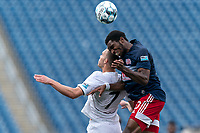 FOXBOROUGH, MA - JULY 25: USL League One (United Soccer League) match. Ethan Vanacore-Decker #7 of Union Omaha  and Jon Bell #70 of New England Revolution II battle for head ball during a game between Union Omaha and New England Revolution II at Gillette Stadium on July 25, 2020 in Foxborough, Massachusetts.