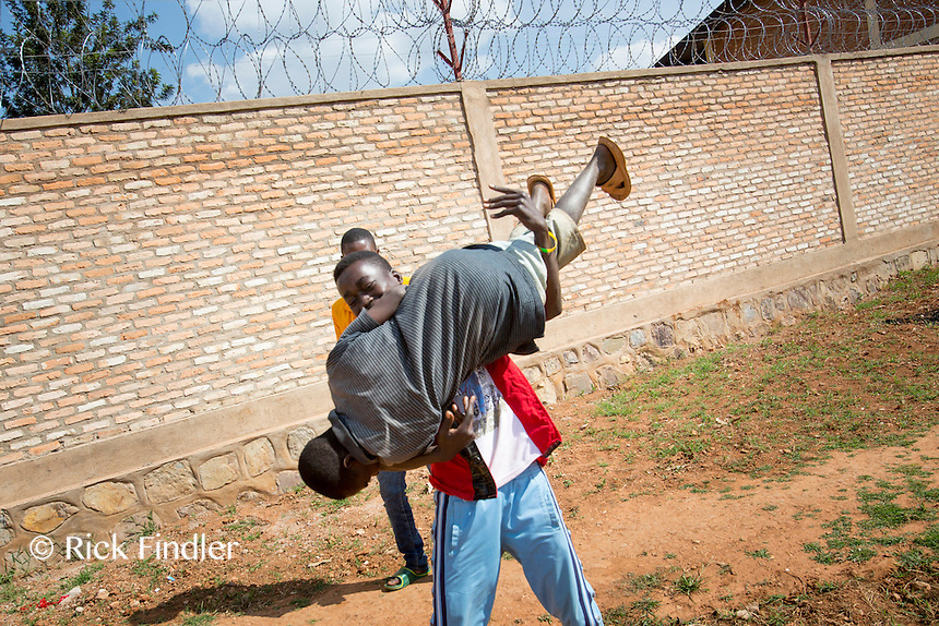 BURUNDI, Ruyigi: 10 June 2015 Ruyigi Re-education Centre Feature.<br /> See accompanying article for general information. <br /> Pictured:  Inmates wrestle and play in the centre.<br /> Rick Findler / Story Picture Agency