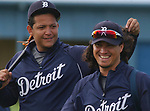 Detroit Tigers third baseman Miguel Cabrera, left, plays with the long hair of teammate Magglio Ordonez as they head for a team workout, Monday, February 25, 2008, in Lakeland, FL.  (The Oakland Press/Jose Juarez)