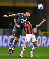 Artur Ionita of Benevento Calcio and Ismael Bennacer of AC Milan compete for the ball during the Serie A football match between AC Milan and Benevento Calcio at San Siro Stadium in Milano  (Italy), May 1st, 2021. Photo Matteo Gribaudi / Image Sport / Insidefoto