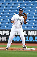 Lake County Captains first baseman Nellie Rodriguez (25) takes a throw during a game against the Dayton Dragons on June 8, 2014 at Classic Park in Eastlake, Ohio.  Lake County defeated Dayton 4-2.  (Mike Janes/Four Seam Images)