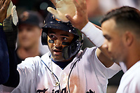 Lakeland Flying Tigers right fielder Derek Hill (18) high fives with teammates in the dugout during a game against the Tampa Tarpons on April 5, 2018 at Publix Field at Joker Marchant Stadium in Lakeland, Florida.  Tampa defeated Lakeland 4-2.  (Mike Janes/Four Seam Images)