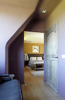 The guest bedroom is decorated in subtle and restful tones of yellow and purple