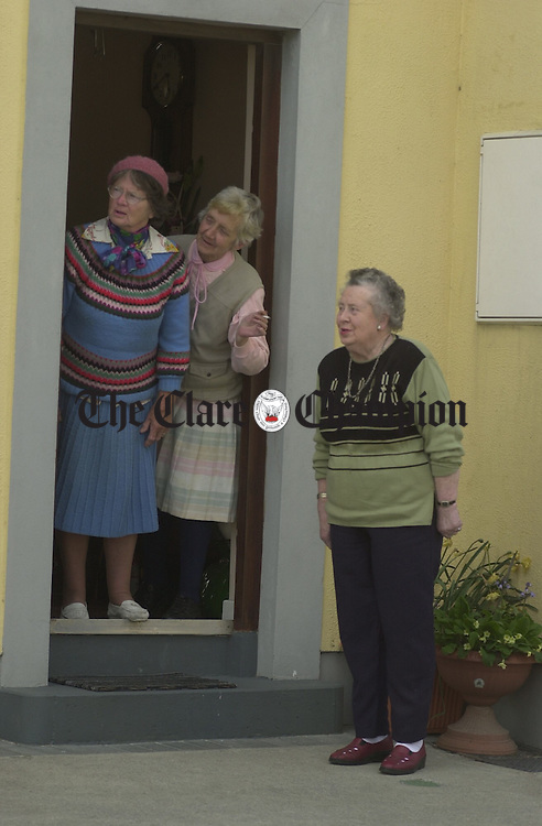 Friends, Susan Crawford, Christine Cunniffe and Mary Walsh stop for a chat in Miltown Malbay. Photograph by John Kelly.