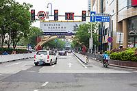 Nanjing, Jiangsu, China.  Street Traffic, Separate Lane for Motorbikes and Bicycles.