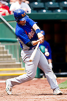 Petey Paramore (7) of the Midland RockHounds makes contact on a pitch during a game against the Springfield Cardinals on April 19, 2011 at Hammons Field in Springfield, Missouri.  Photo By David Welker/Four Seam Images