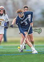 25 April 2015: University of New Hampshire Wildcat Midfielder Laura Puccia, a Senior from Fairport, NY, scoops up a loose ball during action against the University of Vermont Catamounts at Virtue Field in Burlington, Vermont. The Lady Catamounts defeated the Lady Wildcats 12-10 in the final game of the season, advancing to the America East playoffs. Mandatory Credit: Ed Wolfstein Photo *** RAW (NEF) Image File Available ***