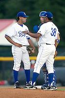Burlington pitching coach Jose Bautista (38) chats with starting pitcher Eduardo Paulino (35) and catcher Nick Doscher (8) at Burlington Athletic Park in Burlington, NC, Saturday, August 25, 2007.