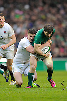 Gordon D'Arcy of Ireland is tackled by Owen Farrell of England during the RBS 6 Nations match between Ireland and England at the Aviva Stadium, Dublin on Sunday 10 February 2013 (Photo by Rob Munro)