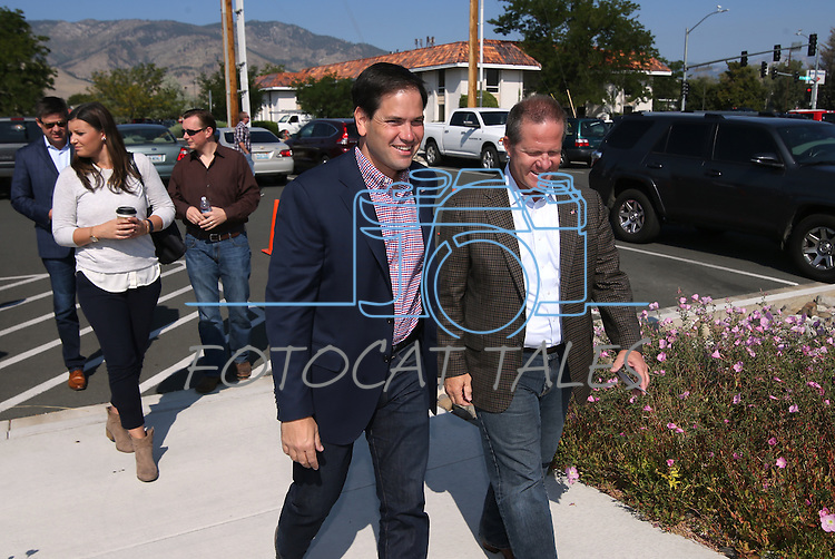 Nevada Lt. Gov. Mark Hutchison, right, greets Florida Sen. Marco Rubio, center, at a campaign stop in Carson City, Nev. on Tuesday, Sept. 1, 2015. The Republican presidential hopeful is stumping in several Northern Nevada towns this week. (Cathleen Allison/Las Vegas Review-Journal)