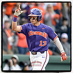 Center fielder Bryce Teodosio (1) of the Clemson Tigers crosses the plate pointing skyward after hitting a home run in the fifth inning in the Reedy River Rivalry game against the South Carolina Gamecocks on Saturday, March 2, 2019, at Fluor Field at the West End in Greenville, South Carolina. Clemson won, 11-5. (Tom Priddy/Four Seam Images)