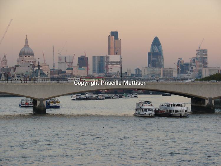 London, England - November 6, 2006:  The London skyline rises above Waterloo Bridge at sunset.