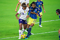 ORLANDO, FL - JANUARY 18: Catarina Macario #29 of the USWNT, Daniela Arias #3 of Colombia battle for the ball during a game between Colombia and USWNT at Exploria Stadium on January 18, 2021 in Orlando, Florida.
