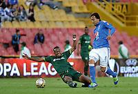 BOGOTA - COLOMBIA -15 -05-2016: Carlos Peralta (Izq.) jugador de La Equidad disputa el balón con Rafael Robayo (Der.) jugador de Millonarios, durante partido entre La Equidad y Millonarios, por la fecha 18 de la Liga Aguila I-2016, jugado en el estadio Nemesio Camacho El Campin de la ciudad de Bogota. / Carlos Peralta (L) player of La Equidad vies for the ball with Rafael Robayo (R) player of Millonarios, during a match La Equidad and Millonarios, for the  date 18 of the Liga Aguila I-2016 at the Nemesio Camacho El Campin Stadium in Bogota city, Photo: VizzorImage  / Luis Ramirez / Staff.