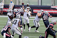 27th September 2020, Foxborough, New England, USA;  Las Vegas Raiders quarterback Derek Carr (4) tosses a pass for Las Vegas Raiders tight end Darren Waller (83) during the game between the New England Patriots and the Las Vegas Raiders