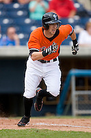 Jeff Fiorentino #20 of the Norfolk Tides hustles down the first base line versus the Toledo Mudhens at Harbor Park June 7, 2009 in Norfolk, Virginia. (Photo by Brian Westerholt / Four Seam Images)