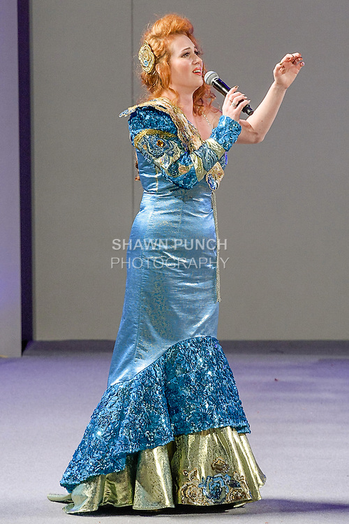 Singer Olga Orlovskaya performs on the runway wearing a couture gown by Evgenia Luzhina-Salazar, during Couture Fashion Week Spring 2013 in NYC, on September 16, 2012.