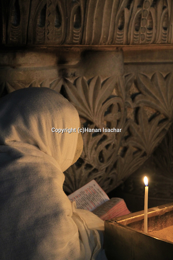 Israel, Jerusalem Old City, a prayer at the Church of the Holy Sepulchre