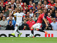 Pictured L-R: Dwight Tiendalli of Swansea against Adnan Januzaj. Saturday 16 August 2014<br /> Re: Premier League Manchester United v Swansea City FC at the Old Trafford, Manchester, UK.