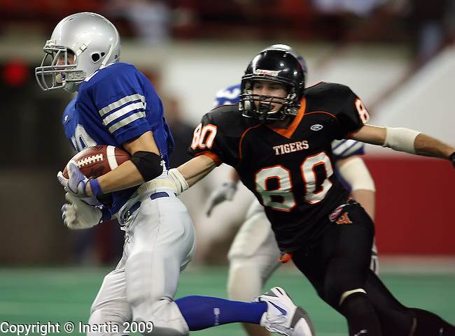 VERMILLION, SD - NOVEMBER 13: Jordon Connor #28 of Emery-Ethan gets a step past Zach Torkelson #80 of Howard in the first quarter of the South Dakota Class 9AA Championship game Friday, Nov. 13, 2009 at the DakotaDome in Vermillion, South Dakota. (Photo by Dave Eggen/Inertia)
