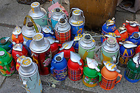 Thermos flasks of Tibetan and sweet tea for sale to pilgrims, outside the Jokhang Temple, Lhasa, Tibet.