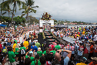 Frederik Van Lierde stands victorious at the 2013 Ironman World Championship in Kailua-Kona, Hawaii on October 12, 2013.