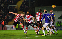 Lincoln City's Mark O'Hara sends a header towards goal<br /> <br /> Photographer Chris Vaughan/CameraSport<br /> <br /> The EFL Sky Bet League Two - Lincoln City v Exeter City - Tuesday 26th February 2019 - Sincil Bank - Lincoln<br /> <br /> World Copyright © 2019 CameraSport. All rights reserved. 43 Linden Ave. Countesthorpe. Leicester. England. LE8 5PG - Tel: +44 (0) 116 277 4147 - admin@camerasport.com - www.camerasport.com
