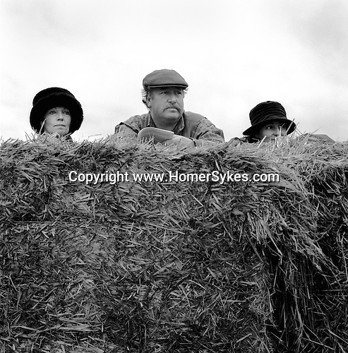 Spectators take cover at Greyhound 2000. Near Six Mile Bottom, Newmarket, Suffolk...Hunting with Hounds / Mansion Editions (isbn 0-9542233-1-4) c