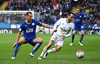 Danny Drinkwater of Leicester City and Leon Britton of Swansea City in action during the Barclays Premier League match between Leicester City and Swansea City played at The King Power Stadium, Leicester on 24th April 2016