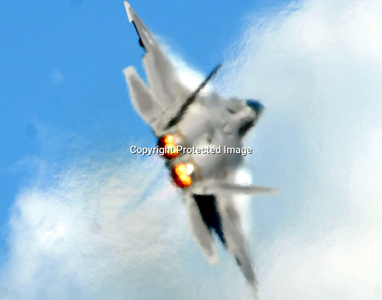Staff Photo/Mike Ullery.An Air Force F-22 Raptor, afterburners lit, is obscured by exhaust plumes as it performs at the Gathering of Mustangs and Legends.