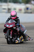 Aug. 20, 2011; Brainerd, MN, USA: NHRA pro stock motorcycle rider Angie Smith during qualifying for the Lucas Oil Nationals at Brainerd International Raceway. Mandatory Credit: Mark J. Rebilas-
