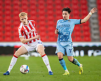 21st April 2021; Bet365 Stadium, Stoke, Staffordshire, England; English Football League Championship Football, Stoke City versus Coventry; Connor Taylor of Stoke City under pressure from Callum O'Hare of Coventry City