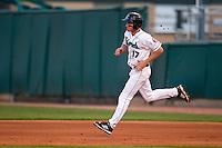 Cedar Rapids Kernels third baseman Travis Harrison #17 runs during a game against the Lansing Lugnuts at Veterans Memorial Stadium on April 29, 2013 in Cedar Rapids, Iowa. (Brace Hemmelgarn/Four Seam Images)
