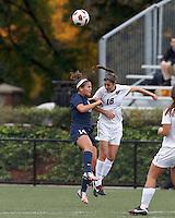 Yale University forward Paula Hagopian (14) and Harvard University midfielder Kate Makaroff (18) battle for head ball. In overtime, Harvard University defeated Yale University,1-0, at Soldiers Field Soccer Stadium, on September 29, 2012.