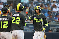 Ben Baird (7) of the West team is greeted by Nicholas Quintana (12) and Mickey Moniak (22) after scoring during the 2015 Perfect Game All-American Classic at Petco Park on August 16, 2015 in San Diego, California. The East squad defeated the West, 3-1. (Larry Goren/Four Seam Images)