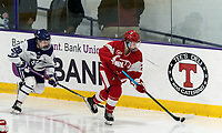 WORCESTER, MA - FEBRUARY 08: Alex Allan #2 of Boston University brings the puck forward as Carlie Magier #28 of Holy Cross closes during a game between Boston University and College of the Holy Cross at Hart Center Rink on February 08, 2020 in Worcester, Massachusetts.