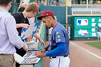 Frisco RoughRiders Ronald Guzman (11) signs autographs before a Texas League game against the Springfield Cardinals on May 6, 2019 at Dr Pepper Ballpark in Frisco, Texas.  (Mike Augustin/Four Seam Images)