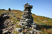 Rock cairns along the Appalachian Trail (Beaver Brook Trail) near the summit of Mount Moosilauke in the New Hampshire White Mountains town of Benton, New Hampshire during the summer months.