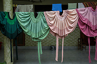 """Traditional Bolivian indigenous skirts called """"polleras"""", hang to drying in the yard of a local family, in Entre Rios, Chapare province, Bolivia. November 28, 2019.<br /> Jupes traditionnelles boliviennes appelées """"polleras"""", accrochées à la cour d'une famille locale, à Entre Rios, dans la province du Chapare, en Bolivie. 28 novembre 2019."""