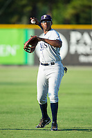 Nic Wilson (44) of the Princeton Rays warms up in the outfield prior to the game against the Burlington Royals at Burlington Athletic Park on July 11, 2014 in Burlington, North Carolina.  The Rays defeated the Royals 5-3.  (Brian Westerholt/Four Seam Images)