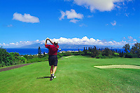 Playing golf at Kapalua, Maui. Island of Molokai in the distance.