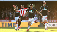 Bryan Mbeumo of Brentford in action as Middlesbrough's Lewis Wing gets ready to make a challenge during Brentford vs Middlesbrough, Sky Bet EFL Championship Football at Griffin Park on 8th February 2020