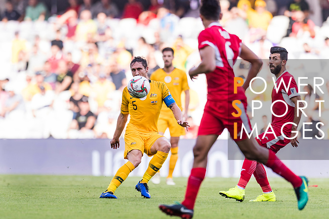 Mark Milligan of Australia (L) in action during the AFC Asian Cup UAE 2019 Group B match between Australia (AUS) and Jordan (JOR) at Hazza Bin Zayed Stadium on 06 January 2019 in Al Ain, United Arab Emirates. Photo by Marcio Rodrigo Machado / Power Sport Images
