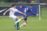 Artem Kasimov of Zenit St Petersburg trips Chelsea' s Jude Soonsup-Bell  and the referee awards Chelsea a penalty during Chelsea Under-19 vs FC Zenit Under-19, UEFA Youth League Football at Cobham Training Ground on 14th September 2021