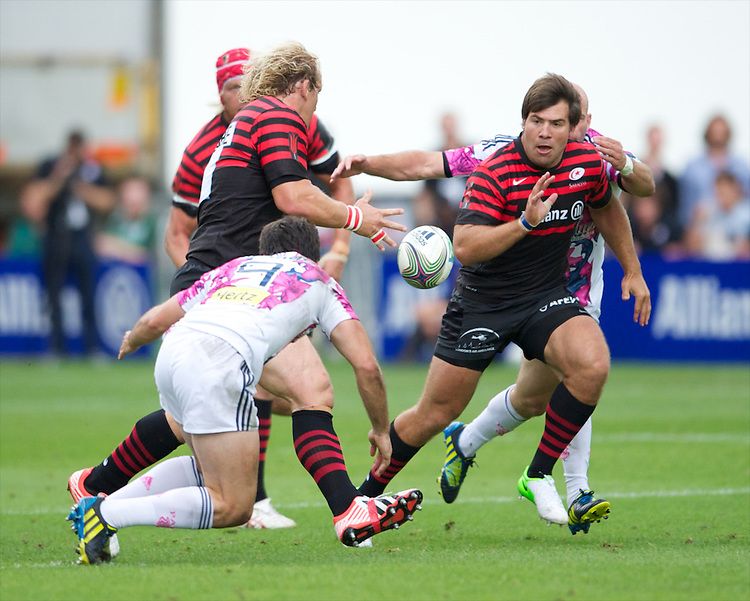 20120823 Copyright onEdition 2012©.Free for editorial use image, please credit: onEdition..Petrus du Plessis of Saracens offloads to Schalk Brits of Saracens at The Honourable Artillery Company, London in the pre-season friendly between Saracens and Stade Francais Paris...For press contacts contact: Sam Feasey at brandRapport on M: +44 (0)7717 757114 E: SFeasey@brand-rapport.com..If you require a higher resolution image or you have any other onEdition photographic enquiries, please contact onEdition on 0845 900 2 900 or email info@onEdition.com.This image is copyright the onEdition 2012©..This image has been supplied by onEdition and must be credited onEdition. The author is asserting his full Moral rights in relation to the publication of this image. Rights for onward transmission of any image or file is not granted or implied. Changing or deleting Copyright information is illegal as specified in the Copyright, Design and Patents Act 1988. If you are in any way unsure of your right to publish this image please contact onEdition on 0845 900 2 900 or email info@onEdition.com