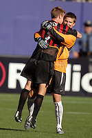 MetroStars' goalkeeper Zach Wells hugs teammate Chris Leitch after the the MetroStars dramatic victory. The LA Galaxy were defeated by the NY/NJ MetroStars 2 to 1 at Giant's Stadium, East Rutherford, NJ, on June 19, 2004.