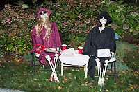 Life-sized skeletons are dressed up for Halloween decorations along Hillcrest Road in Belmont, Massachusetts, USA, on Mon., Oct. 30, 2017. A resident said the neighborhood has been doing similar coordinated decorations along the road for the previous 3 or 4 years. In this image, the skeletons are dressed as high school or college graduates and drinking from red Solo cups.