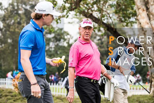 Miguel Angel Jimenez of Spain talks with Sean Crocker of the United States after teeing off during the day three of UBS Hong Kong Open 2017 at the Hong Kong Golf Club on 25 November 2017, in Hong Kong, Hong Kong. Photo by Yu Chun Christopher Wong / Power Sport Images